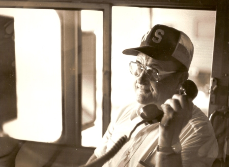 Although less common today, many radios in locomotives once had telephone-type handsets. The transmitter button was located between the earpiece and the mouthpiece. Shown is Conrail locomotive engineer Russell Smith inside an Amtrak F40PH at Indianapolis Union Station. Smith was the engineer of the last westbound National Limited, which departed Indianapolis on October 1, 1979. (Photograph by Craig Sanders)