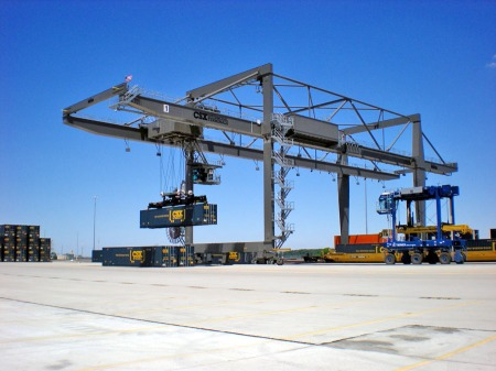 A wide-span crane shuffles containers at the CSX North Baltimore intermodal hub in June 2011. (Photograph by Craig Sanders)