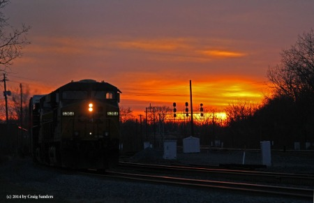 The money shot of the day. The sun has has just dipped below the horizon but the light reflecting on the clouds and sky made for a nice sight as an eastbound manifest freight approaches.