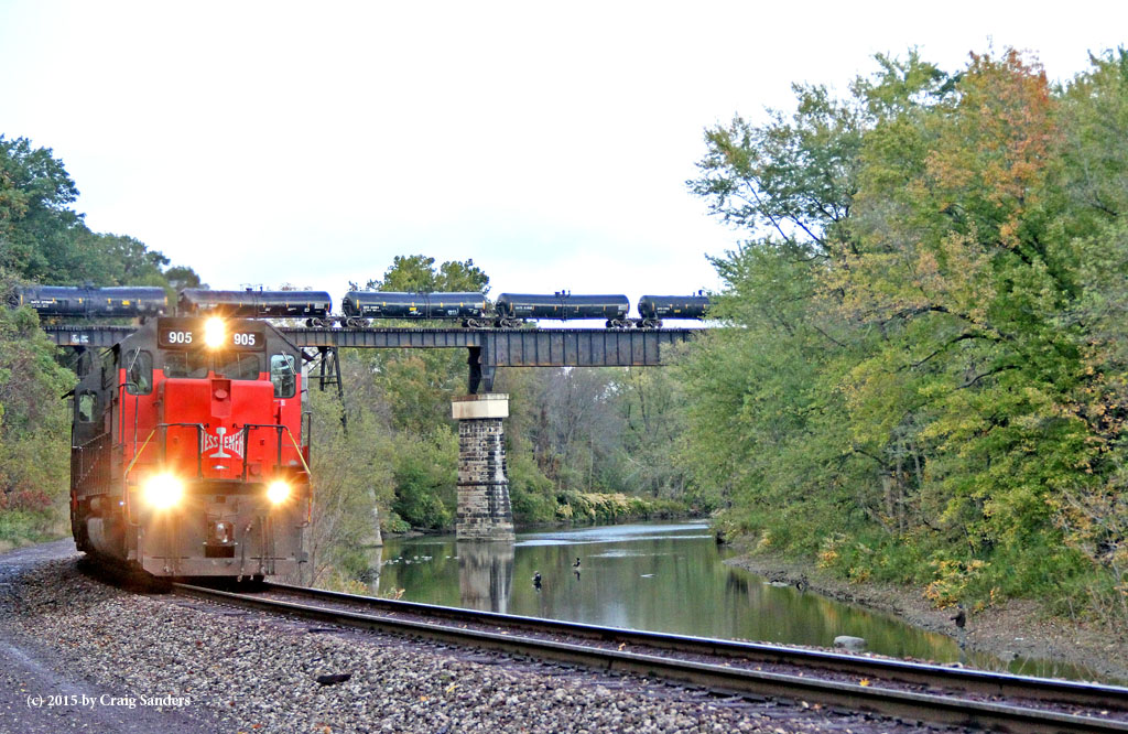 A cut of tank cars on NS 145 rolls over Conneaut Creek as the 905 continues toward the rest of its train. The fishing must have been good on this morning because a lot of anglers were casting lines in the creek.