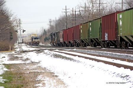 A meet between an eastbound grain train and a westbound stack train.