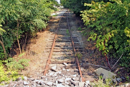 A short stretch of the former B&O remains in place for the W&LE to serve a grain elevator. But this segment of the B&O is used only as a tail track that ends at a pile of ballast north of where the B&O and W&LE used to cross on a diamond.