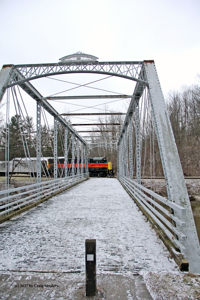 Looking down Old Station Road bridge at the nose of the CVSR 4241.