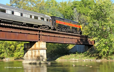 CVSR observation-lounge car Saint Lucie Sound trails behind FPA-4 No. 6771 while crossing the Cuyahoga River in September 2016 south of Peninsula.